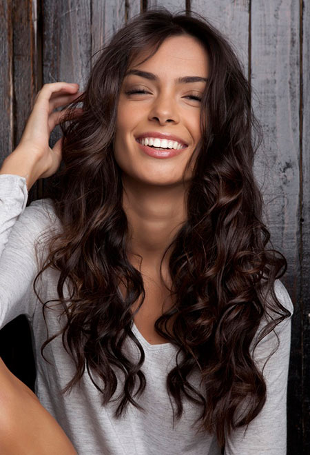 Woman with long curly hairstyle