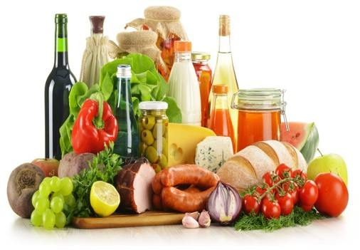 Assorted foods, including deli meats, oils, vegetables, and bread