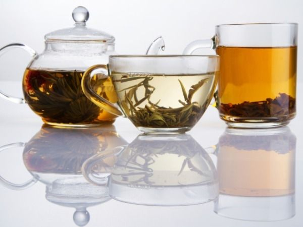 Assorted tea in teapot and cups