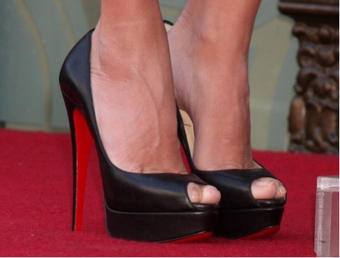 Woman's feet in six-inch high heels