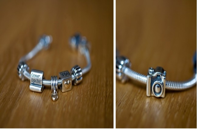 Charm bracelet on wooden table