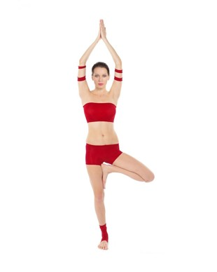Woman in red top and shorts doing yoga pose