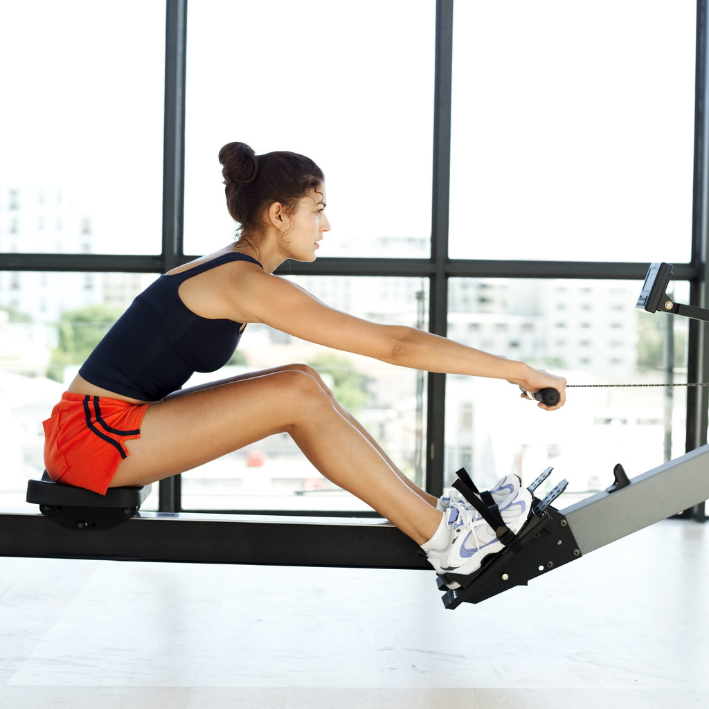 Woman using the rowing machine