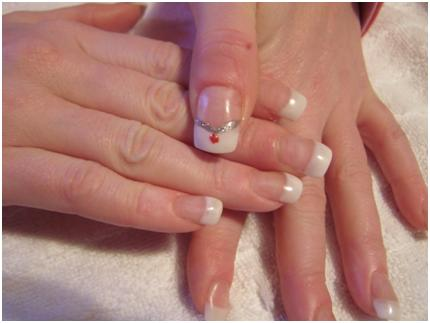 Woman's fingers with white cuticles