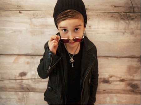 Young child in sunglasses and black beanie