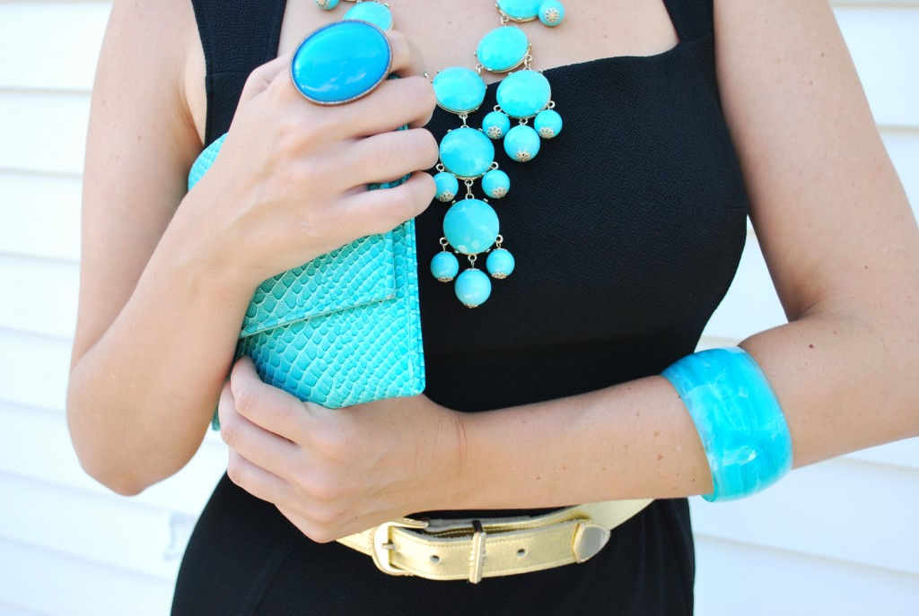Woman with matching bright blue accessories and purse
