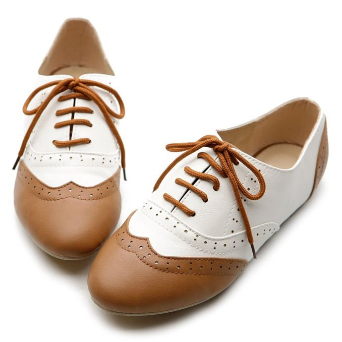 Oxford style shoes on white background