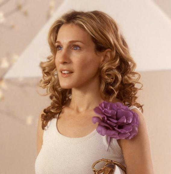 Carrie Bradshaw in tank top and purple flower