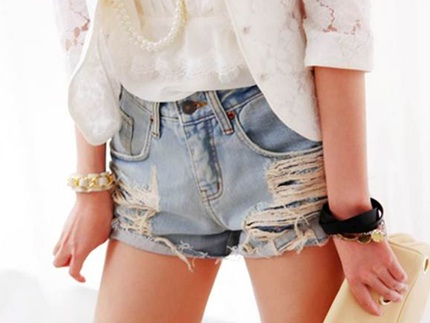 Cut off denim shorts on young woman