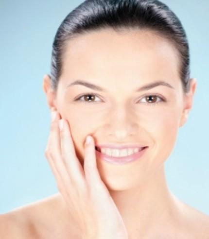 Smiling woman touching skin