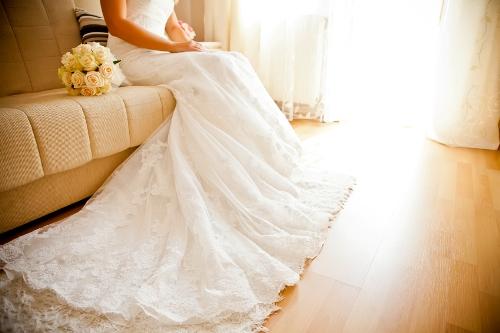 Long train of woman's white wedding dress