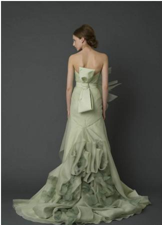 Woman with long, pale green wedding dress