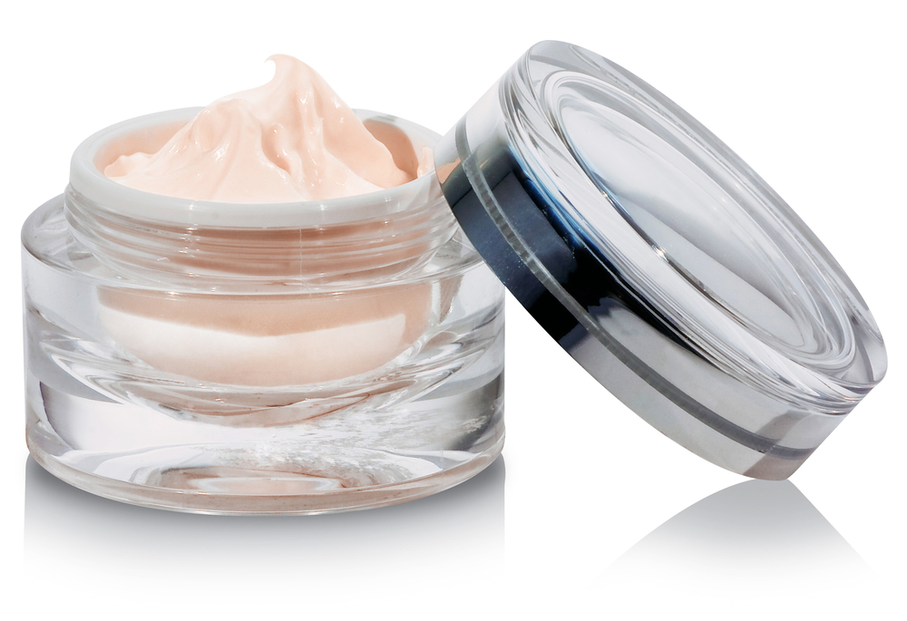 Moisturizer in an open-lid jar