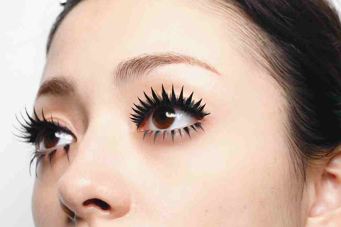 Woman with long false lashes