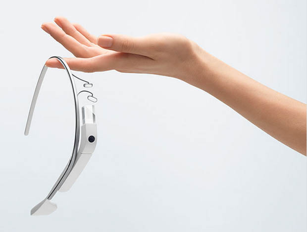 Female hand holding Google glasses