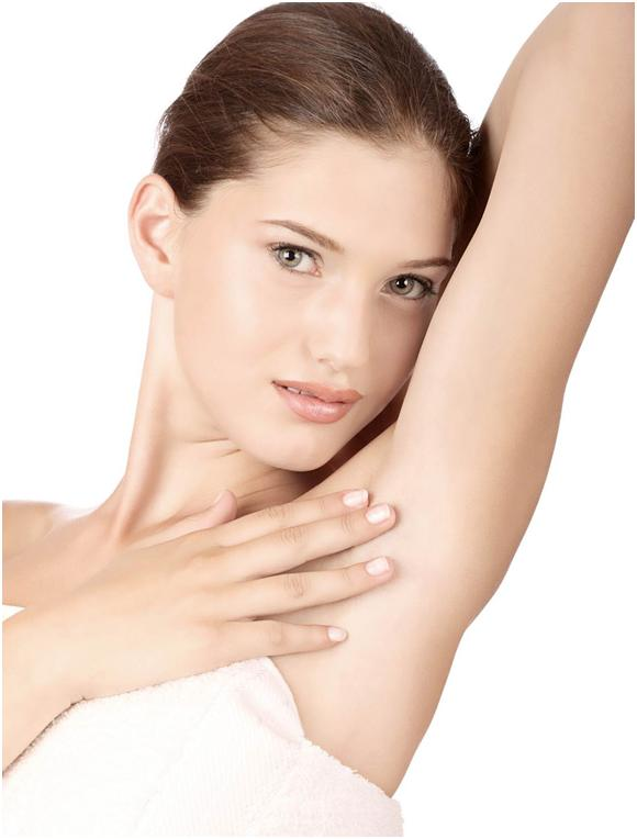Woman showing her smooth armpit