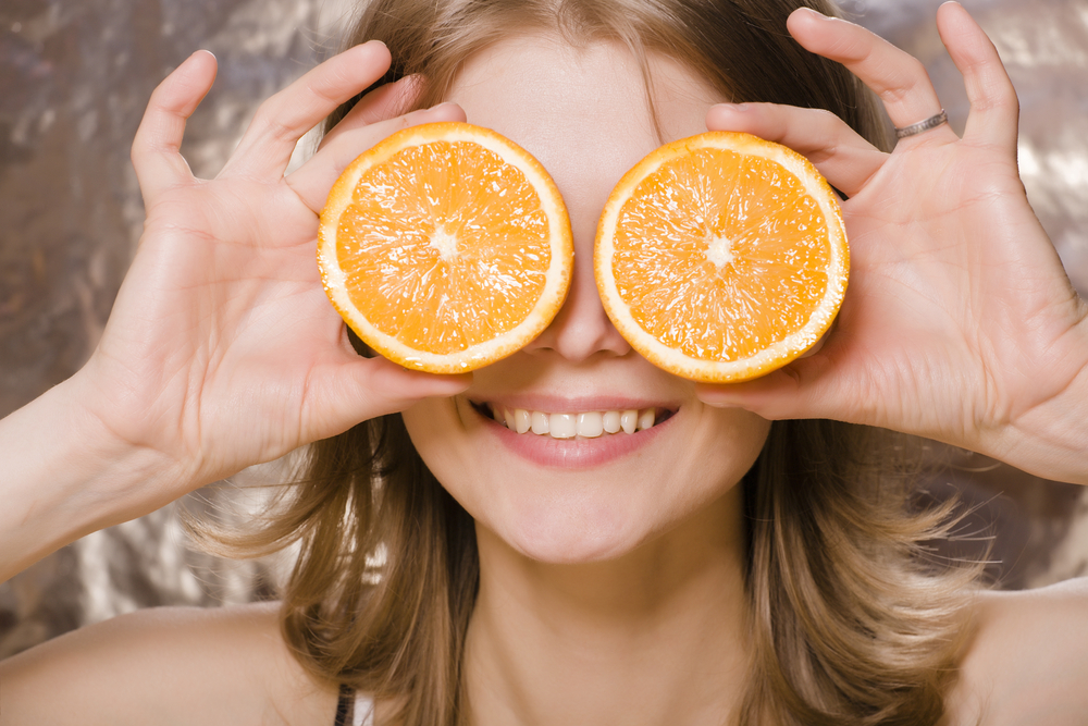 Woman holding orange slices
