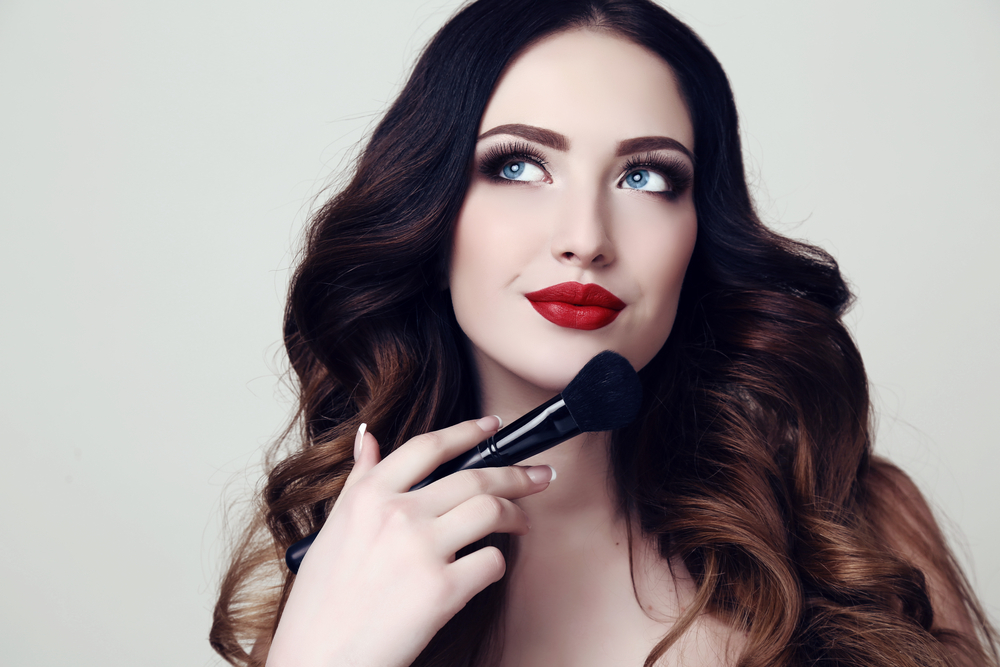 Woman holding a makeup brush