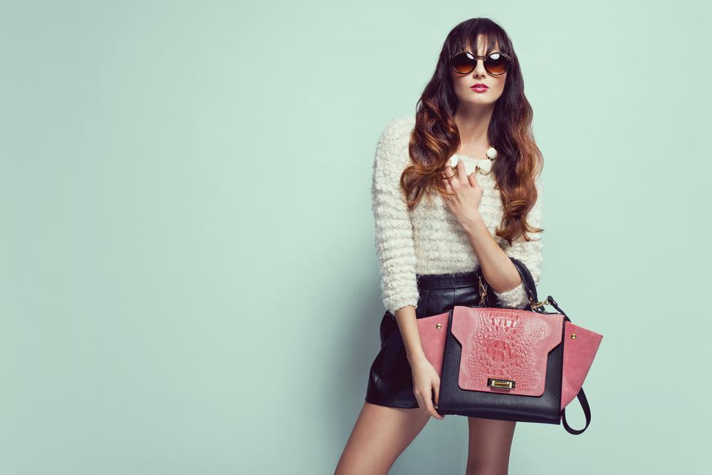 Woman holding a stylish purse