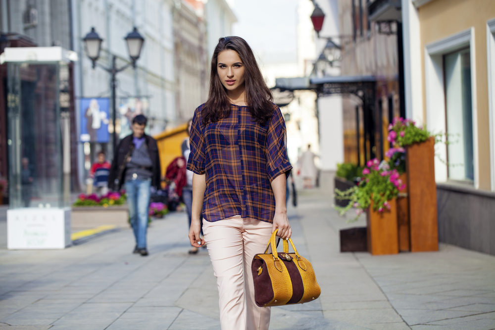 Stylish woman walking on the street