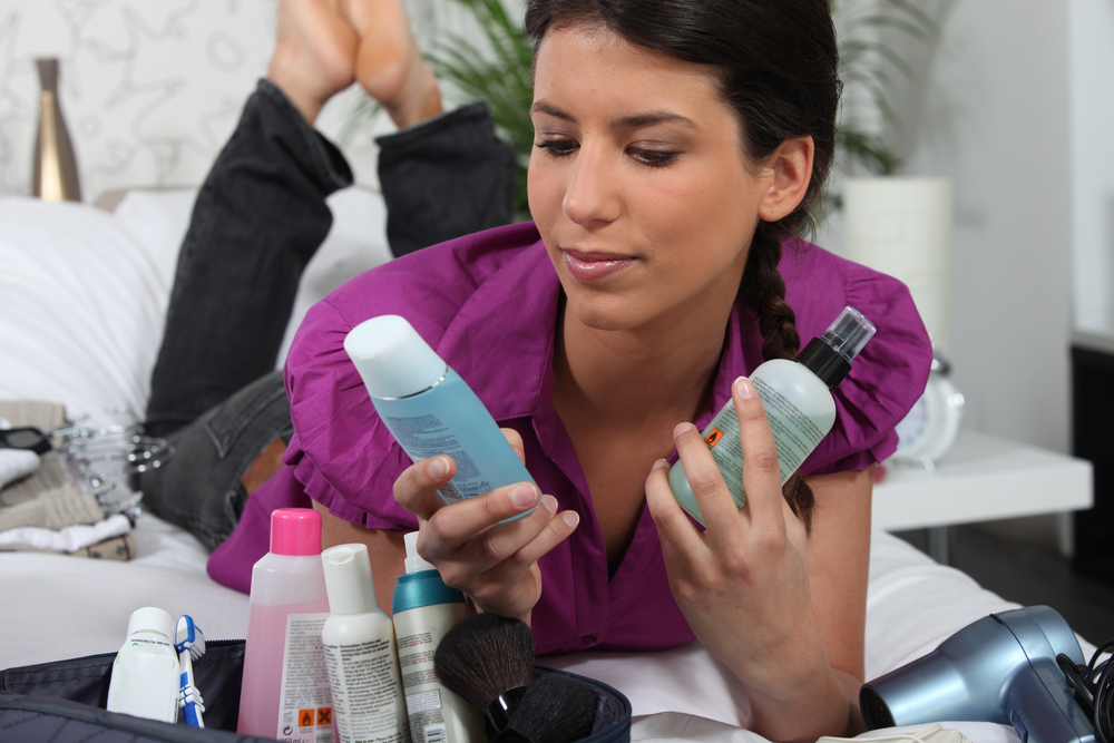 Woman packing toiletry bg