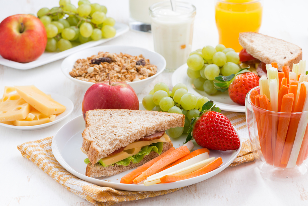 Healthy breakfast with fruit and sandwich