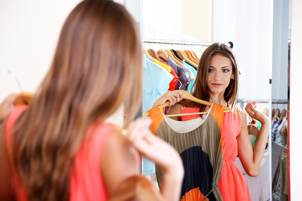 Woman choosing a dress to wear