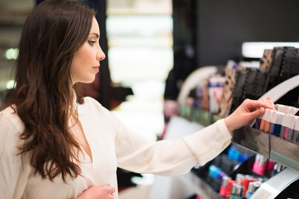 Woman choosing makeup products