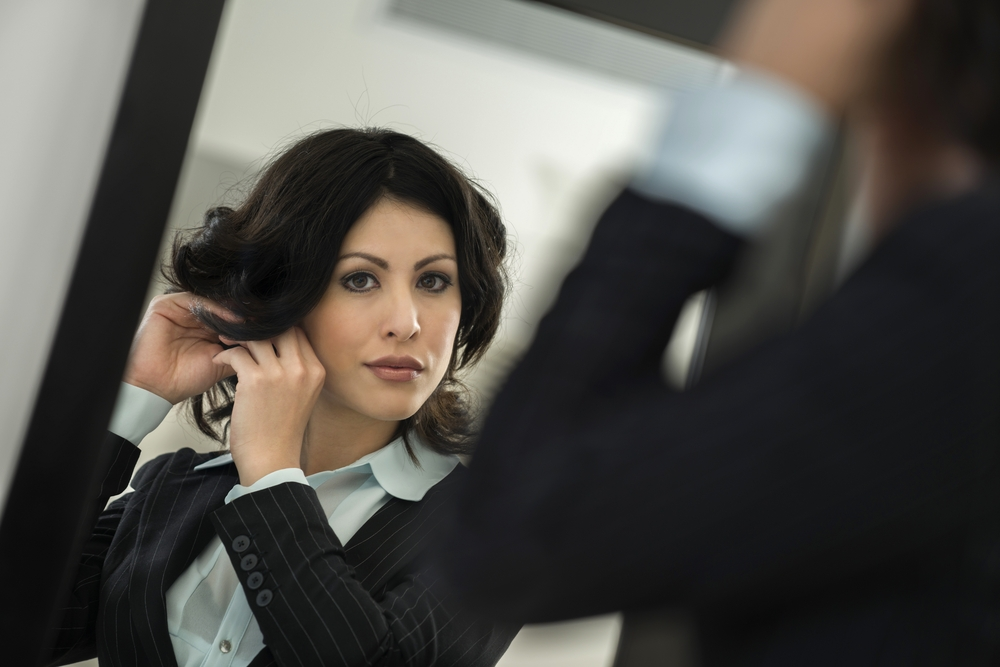 Woman getting ready in mirror