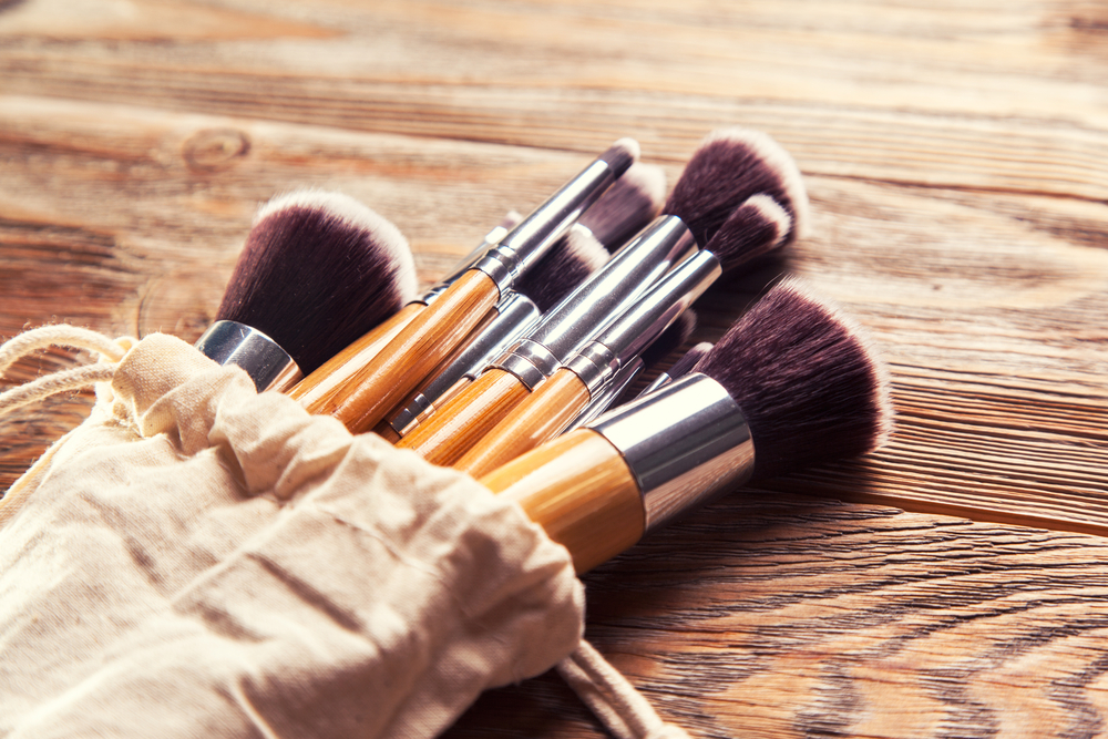Makeup brushes on wooden table