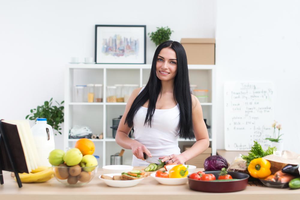 Women prepping veggies in the kitchen.