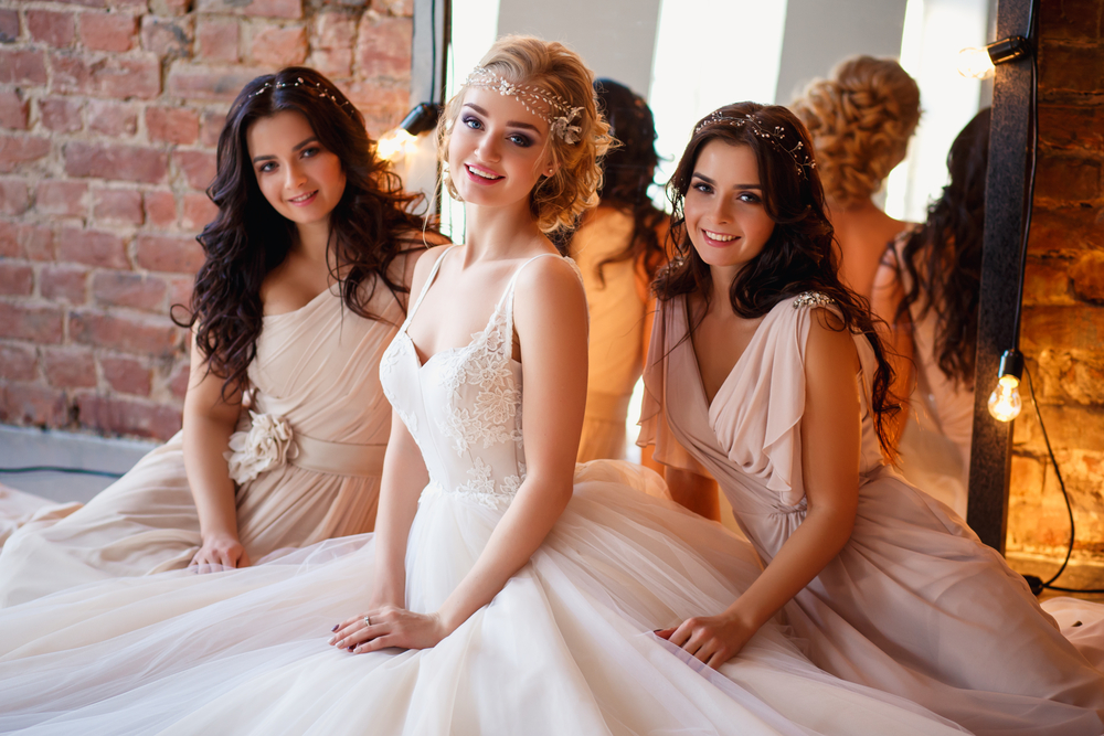 Bride with her bridesmaid.s