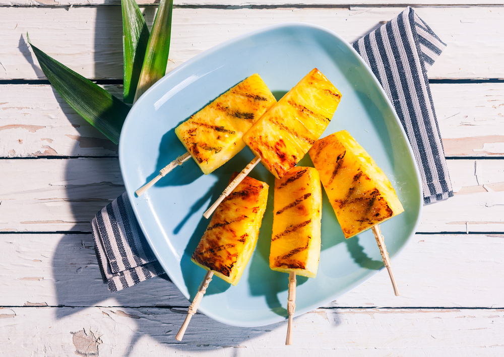 Grilled pineapples on a plate