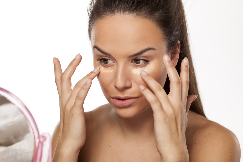 Woman applying liquid foundation