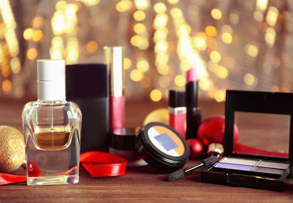 Makeup products against holiday lights