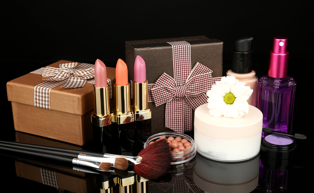 Makeup products on black marble table