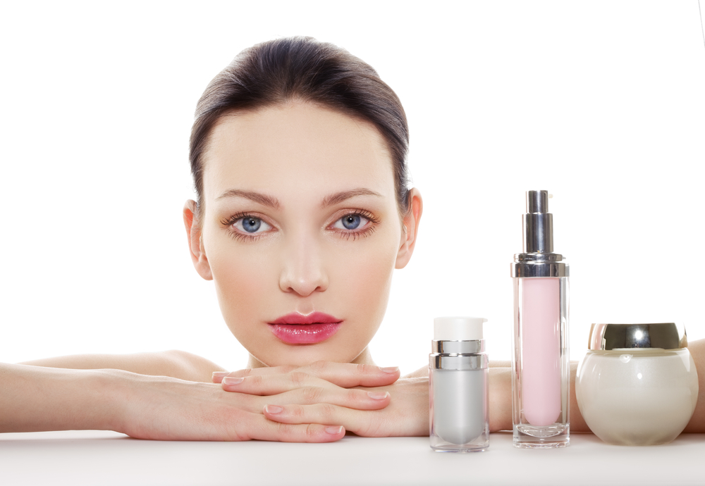 Woman with skincare products