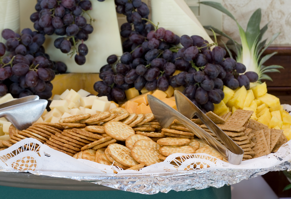 Cheese plate with grapes and crackers