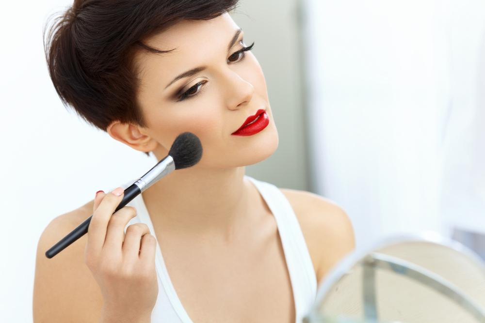 Woman applying blush