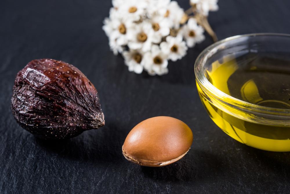 Argan oil and Argan nut on table