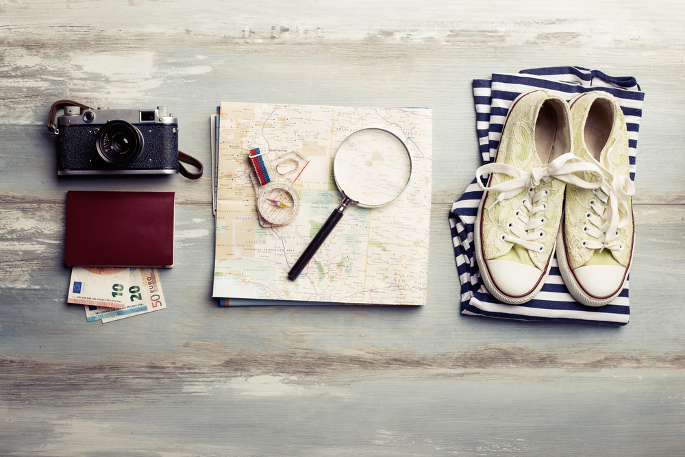 Travel items on wooden table