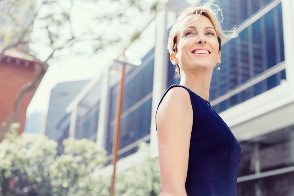 Woman smiling outside office
