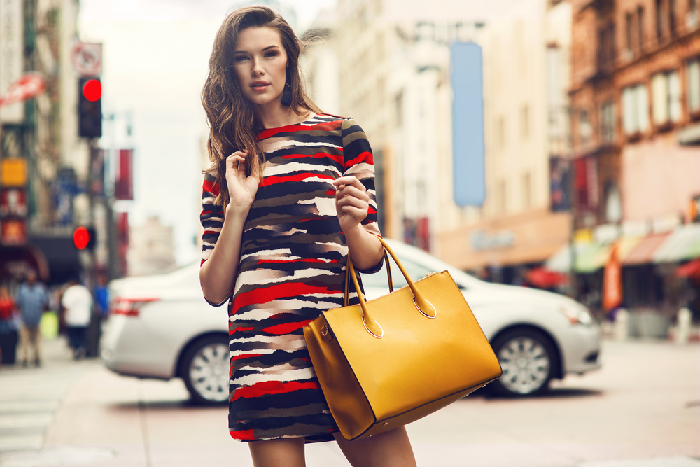 Woman outdoors with fashionable yellow bag