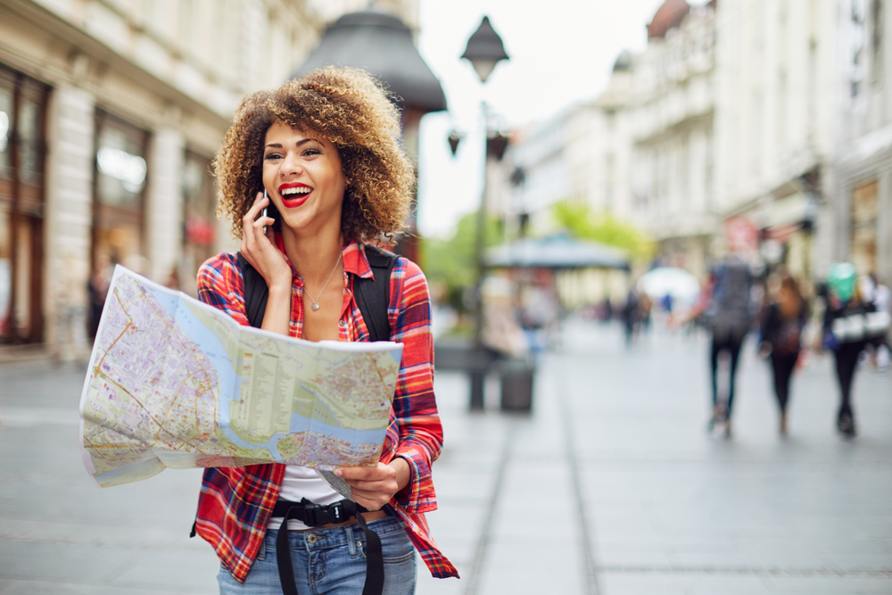 Woman using map in unknown city