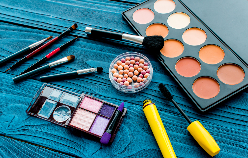 Makeup products on blue table