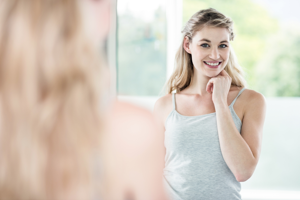 Woman smiling at mirror
