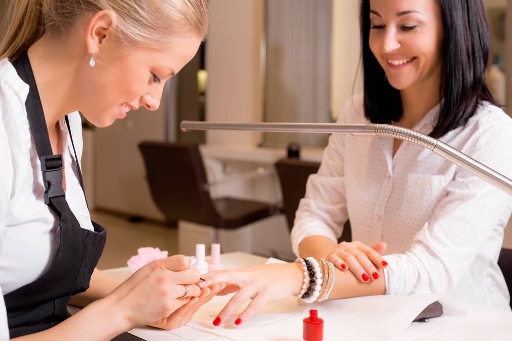 Woman applying nail strengtheners