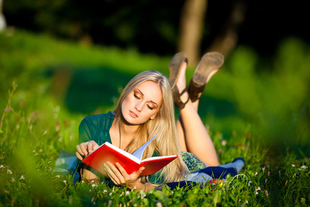 Woman reading in the grass