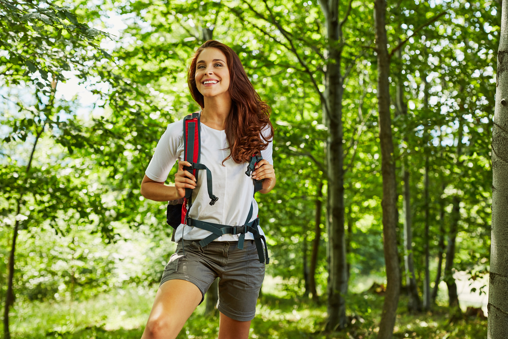 Woman hiking in green forest
