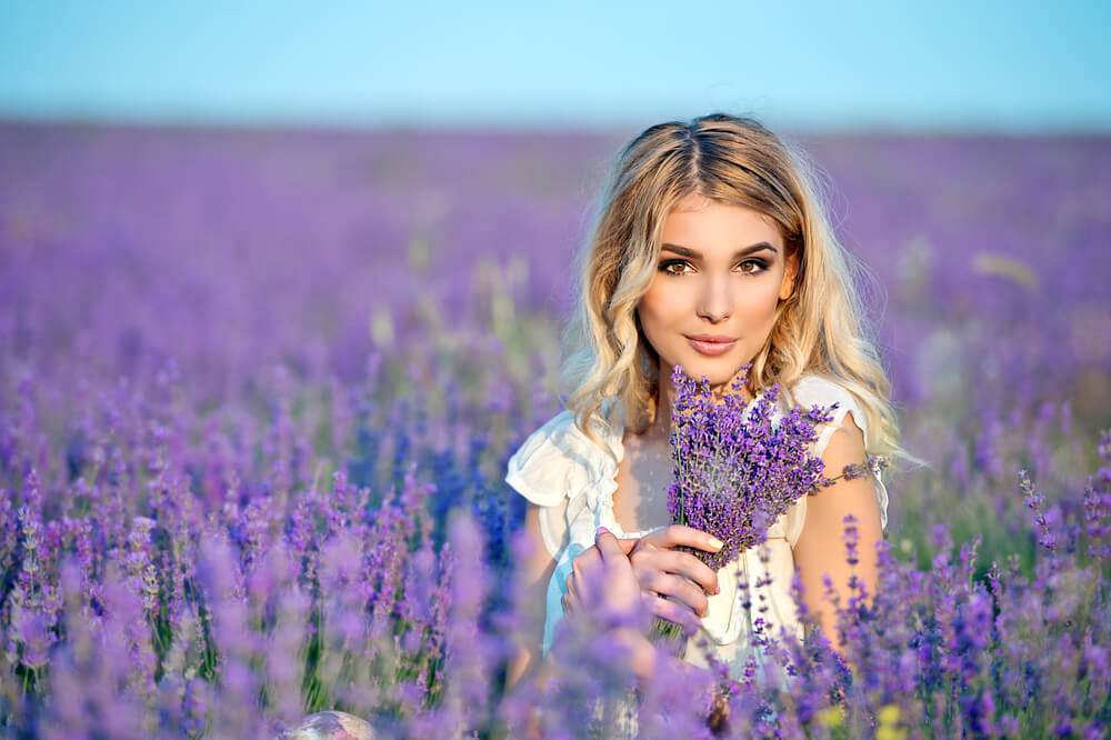 Smiling woman in a field of lavender